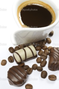 Coffe cup and chocolate candy on white background
