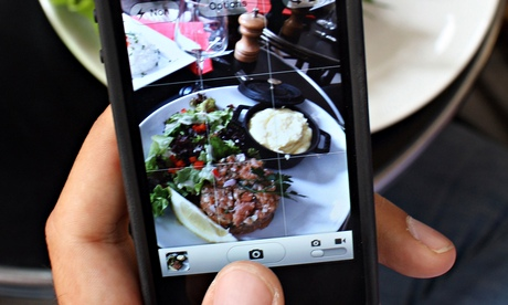taking photograph of food on mobile phone